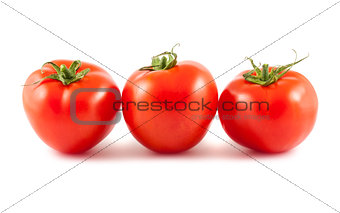 Three red tomato