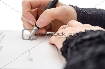 Closeup of a businesswoman signing a contract