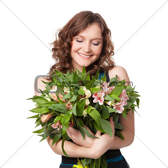 Portrait of pretty brunette holding bouquet of flowers