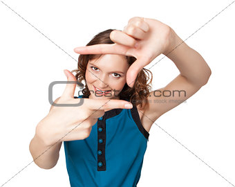 Smiling woman making a frame with fingers
