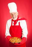 Baker Holding Cherry Pie