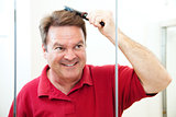 Handsome Mature Man Brushes His Hair