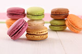 Delicious macaroons on wood table