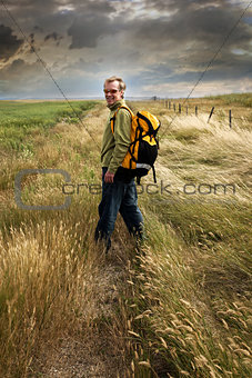 Man looking back and smiling on a country road
