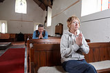 Two people praying