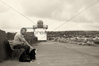 A mature man and his dog