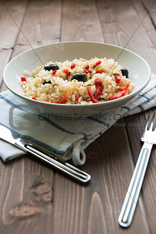Rice with red capsicum and black olives