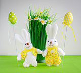 Easter funny bunnies with eggs and flowers
