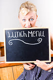 Hungry woman eating a cafe lunch menu