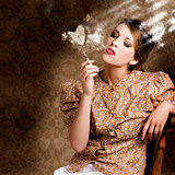 Pinup portrait of a smoking woman blowing hearts