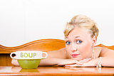 Retro waiter with soup bowl at restaurant counter