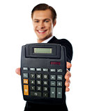 Modern businessman showing calculator