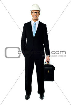 Portrait of smiling young architect carrying briefcase