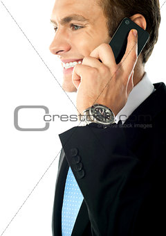 Cropped image of young businessman talking