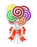 Lollipops with red ribbon.