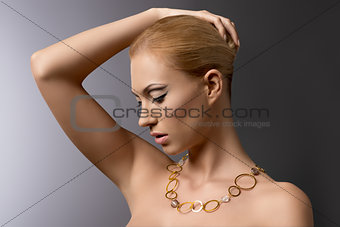 blonde girl with necklace takes her hair
