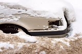 Car under snow in winter