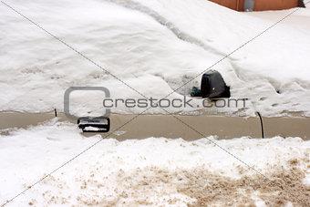 Car under snow in winter