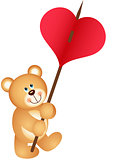 Teddy bear carries heart