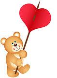 Teddy bear carries heart