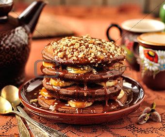 Chocolate Pancakes with Bananas and Caramel Sauce
