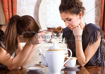 Two friends drink tea