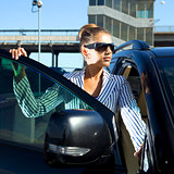 woman in black sunglasses near car