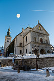 Full Moon above Medieval Church on the Central Square of Megeve,
