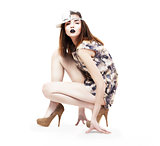 Lifestyle. Glam. Nifty Ultramodern Woman sitting in Heels. Fashion &amp; Glamor
