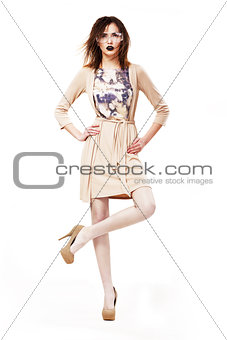 Glamor. Stylish Classy Woman in Modern Glasses standing on one leg