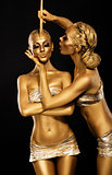 Fantasy. Creativity. Shiny Women&#39;s Gold Gilded Bodies. Arts