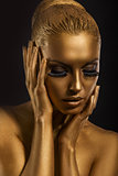 Face Art. Fantastic Gold Make Up. Stylized Colored Woman&#39;s Body