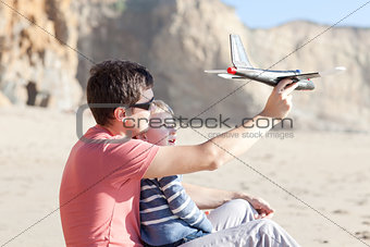playing with a toy plane