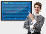 business man pointing finger on diagram of stock market