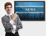 business man pointing finger on digital screen of news