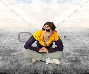 casual girl sitting on cement floor
