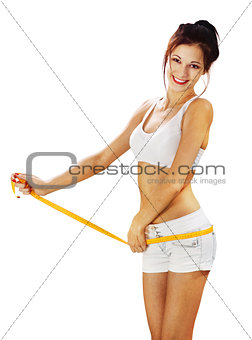happy woman measures her waist l
