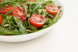 salad from ruccola, cherry tomatoes and cucumber