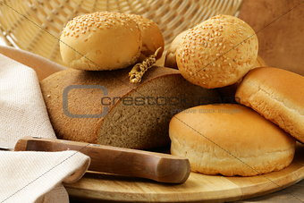 assortment bread on a wooden board
