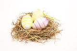 Three easter eggs in straw