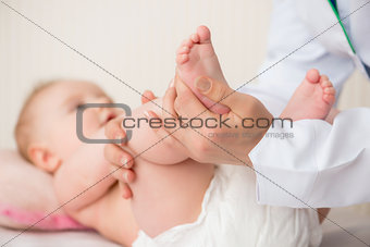 Doctor massaging  baby