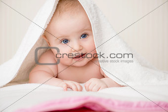 happy baby with towel