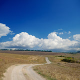 rural road under dramatic cloudy sky
