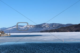 Scene of icy water and mountain range