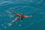 Top view of young woman swimming in the sea.