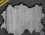 Hole in asphalt road background