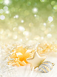 Gold and silver Christmas baubles on background of defocused gol