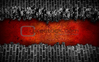 Broken black brick wall  with large red hole