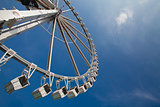 ferris or observation big wheel against blue sky