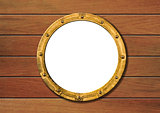 ship porthole on wooden wall isolated